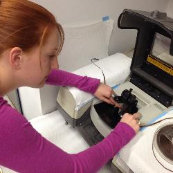 Cassidy uses an infrared spectrophotometer to record the IR spectrum of the surface of an audiotape. The IR spectrum is used to predict whether a tape will cause problems in a tape player.