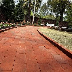 In the garden, the brick pathways go from solid to multicolors, representing the university's desegregation.
