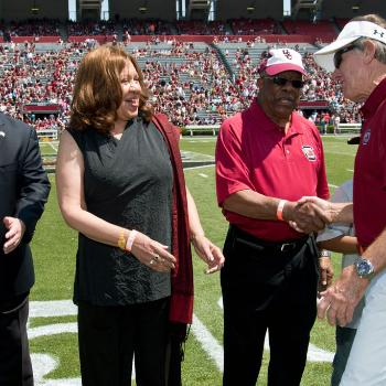 As part of the university's yearlong commemoration of the 50th anniversary of desegregation, two of the first African-American students to enroll at UofSC, Henrie Monteith Treadwell and James Solomon, were recognized at the annual spring football game.