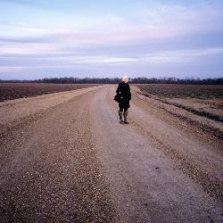 "Kathleen Robbins, professor of photograpy, is documenting changes taking place in the Mississippi Delta. Once the Land of Cotton, the fluffy bolls are being replaced by corn and soybean and the lifestyle associated with the former ""king"" crop."