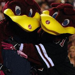 James Armstrong III is the man behind the suit. During his four years as Cocky he led cheers at baseball, football, basketball, soccer and volleyball games. Here he's pictured with Cocky's girlfriend Caroline.