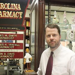 A 1996 graduate of the University of South Carolina who also earned his Doctor of Pharmacy (1997) at Carolina, Bryan Love returned to Columbia to join the faculty of the South Carolina College of Pharmacy in 2010. He's pictured here in the SCCP's Pharmacy Museum.
