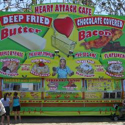 The link between unhealthy eating and its consequences is recognized widely, such as on this sign at the South Carolina State Fair. [Photo by Shekhar Patel]