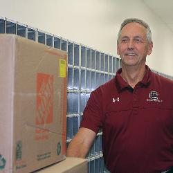 Dan Davis first arrived on the UofSC campus 50 years ago as a student. Today,he works in the campus post office and loves connecting students and their packages on move-in day.