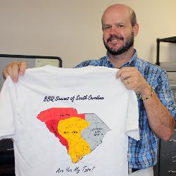 UofSC geography department chair John Kupfer shows the department's famous South Carolina barbecue map.