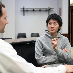 UofSC law student Phillip Martin (left) says his ability to speak Japanese helps him explain things to his conversation partner Hidemaro Ueda, a student in Carolina's English Program for International.