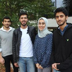Among Carolina's 75 Omani students are several members of the same extended family. From left are Sultan Al Masrouri, a civil engineering major graduating in December, and his cousins; Hamdan Al Masrouri, a sophomore business major; Salima Al Masrouri, a master's in mass communications graduate student graduating in December; and Ishaq Al Masrouri, a freshman business major.