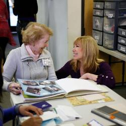 Emmy Award-winning TV talk show host Leeza Gibbons talks with a caregiver at Leeza's Care Connection. (Photo courtesy of Leeza Gibbons)