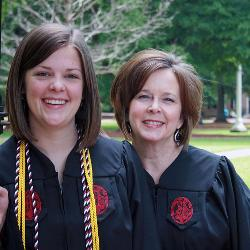 Mom Lisa Jerald graduates with a degree in sociology while daughter Katie earned a business degree in marketing and human resources.
