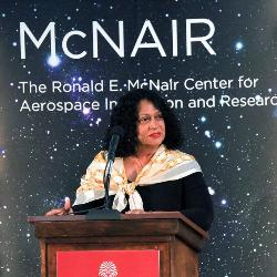 Cheryl McNair speaks at the aerospace center named for her late husband Ronald McNair.
