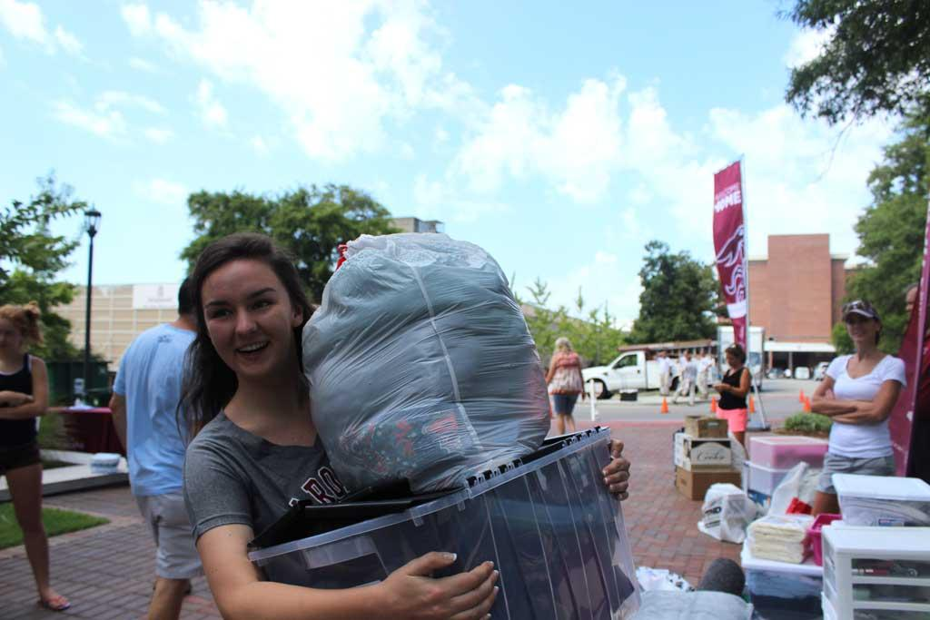 Sophomore Amanda McGuire is lending a helping hand this year with new student move-in.