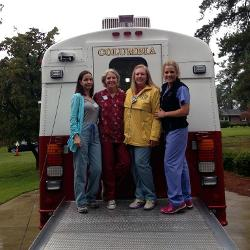 UofSC nursing professors (from left) Bev Baliko, Allyson Bagley, Erin McKinney and 2013 College of Nursing graduate Garner Leigh Caswell provided nursing services at a makeshift health clinic following the flood.