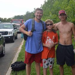 Ethan Hinkle, Alec Mortillite and Mark Kingsmore (left-right) are standing on the side of the road where Hinkle and Kingsmore rescued Alec's father.