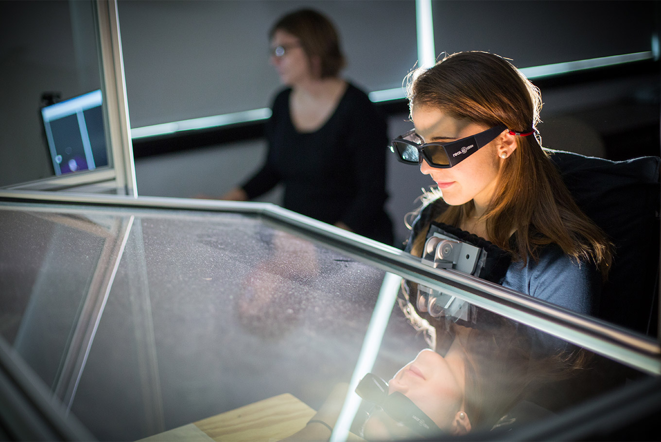 Girl student researching with special glasses