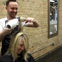 Gregory Garrett, a 2007 graduate, put his hospitality, retail and tourism management degree to work daily at his new salon.