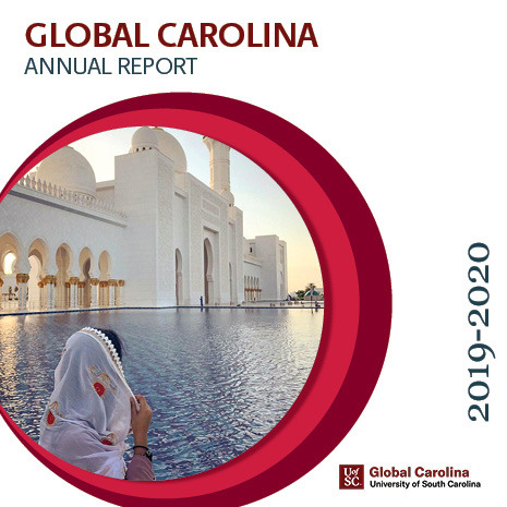 annual report cover 19-2020:girl looking at mosque
