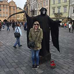 girl standing in front of the grim reaper