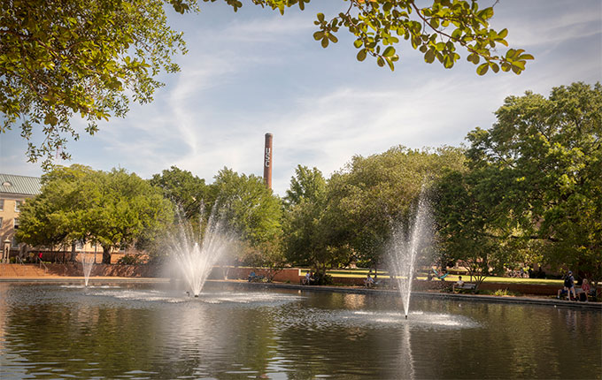 Looking at the smokestack from the reflecting pool in front of Thomas Cooper Library