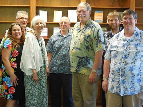 Committee chairs pose together wearing Hawaiian shirts