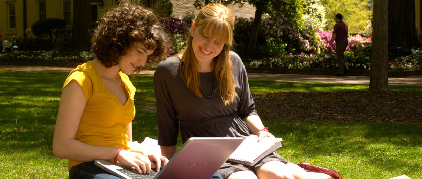 Photo of two USC students looking at a laptop