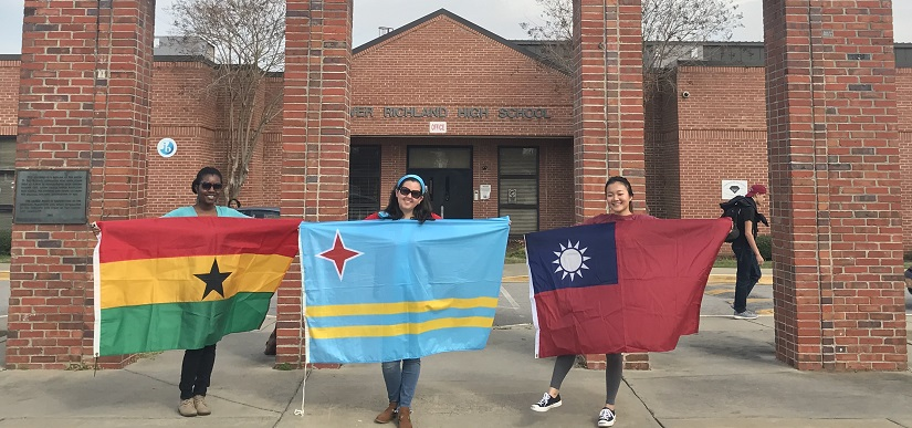 Photo of international students showing their country flags