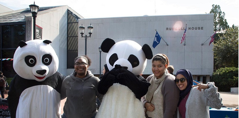 The females pose with the two panda mascots during the Festival event.