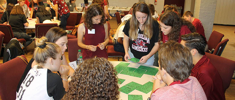 Students participate in a leadership exercise.