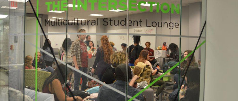 students gather to share conversations in the Intersection Multicultural Student Lounge