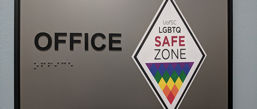 Safe Zone Ally sticker on an office nameplate.