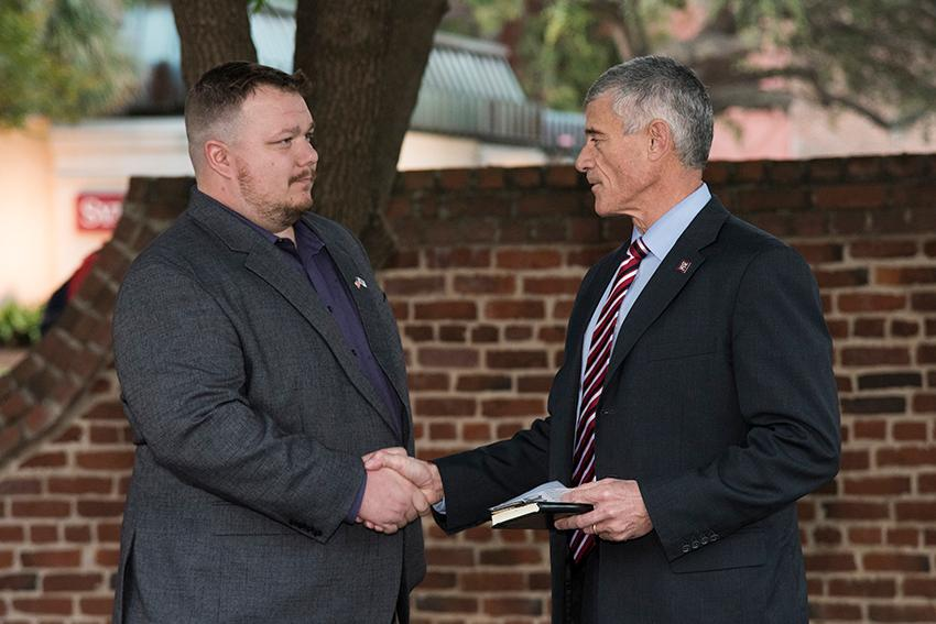 Scott Craig receives the first Purple Heart parking pass from university president Bob Caslen on Veterans Day 2019