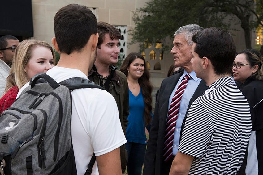 University president Bob Caslen talks with students including student body president Luke Rankin before the ceremony.
