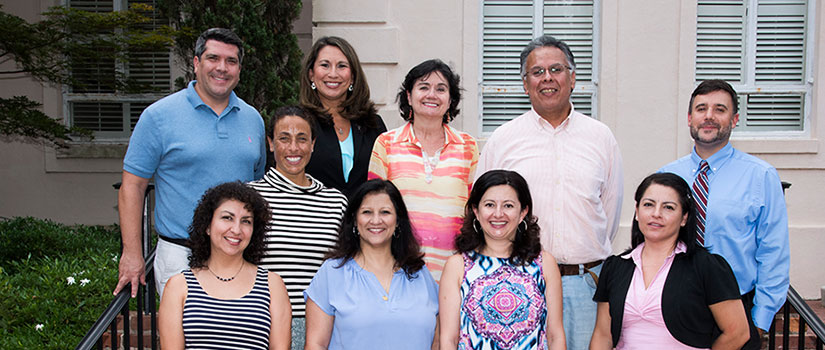 Group portrait of Latino Hispanic Faculty Caucus members on the horseshoe
