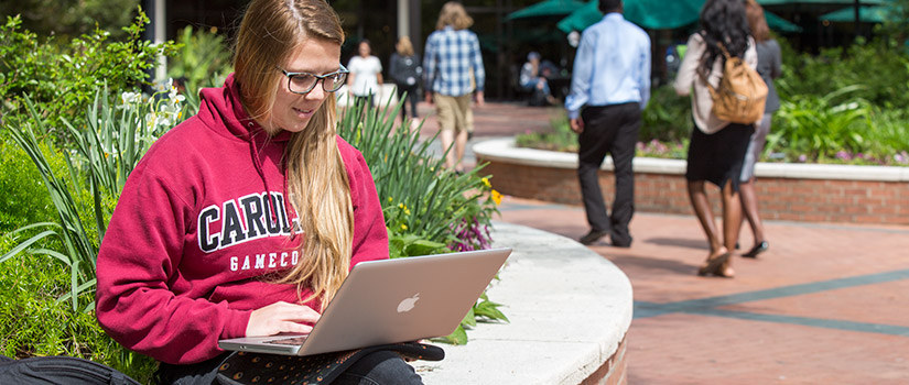student studying on the Russell House patio