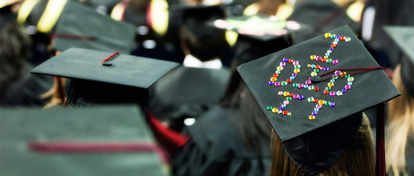 decorated mortar board at commencement ceremony