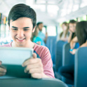 boy looking at ipad on bus