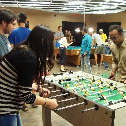 Students playing foosball and pool.