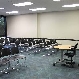 chairs set up for a meeting in the room