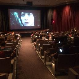 A group of people watching a movie.