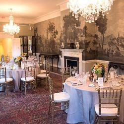 Luncheon honoring a donor in the President's House Reception Room in front of the historic block-printed wallpaper circa 1811Private dinner in President's House Reception Room.jpg