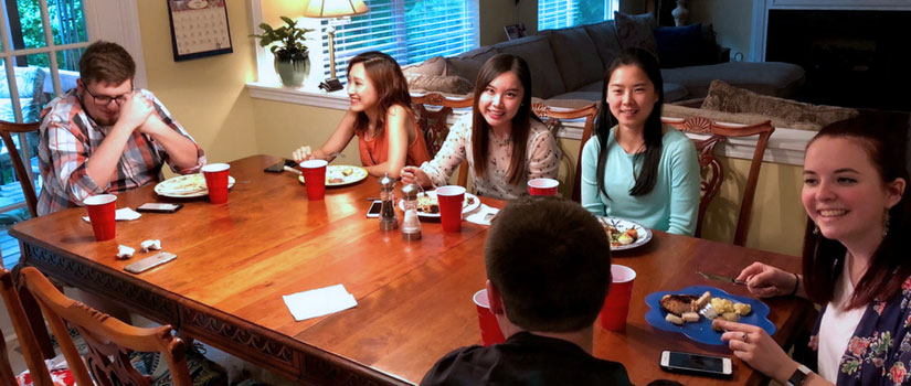 students having dinner at their instructor's home
