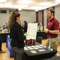 A student talking to a potential employer at the annual Green Career Fair