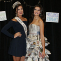 Miss South Carolina posing with a student model who is wearing a dress made out of newspaper