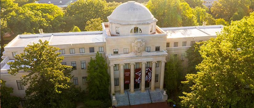 Drone shot of the UofSC Visitor Center on the Horseshoe as the sun is setting