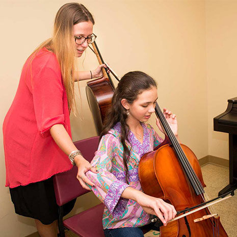 student instructing cello lesson