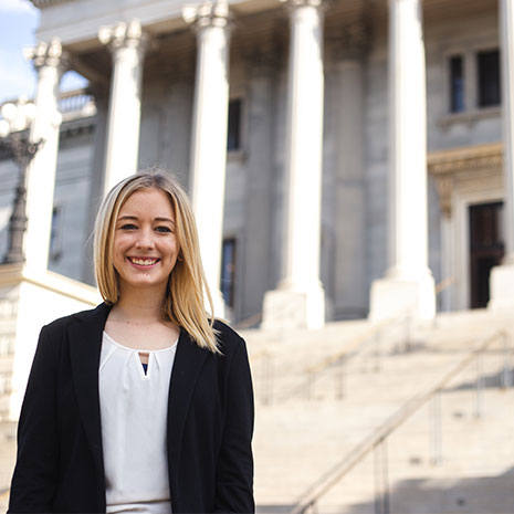 political science student kaci bullard standing in front of the south carolina state house