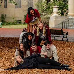 students in pyramid on the Horseshoe in the fall