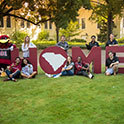 group of students posing in front of HOME letters