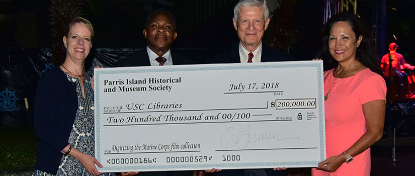 pihms presents usc with check