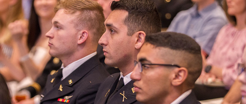 students in uniform listen intently to a presentation