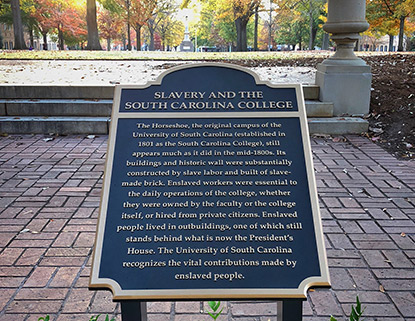 Plaque at the top of the horseshoe acknowledgin the contribution of enslaved people building the original University of South Carolina campus.
